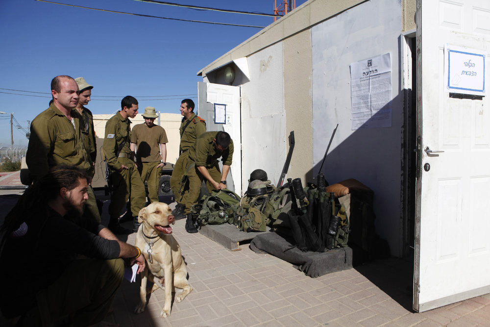 Description of . Israeli soldiers wait outside as the prepare to casts their vote at an army base on January 21, 2013 in Shekef, Israel. The Israeli general election will be held on January 22.  (Photo by Lior Mizrahi/Getty Images)