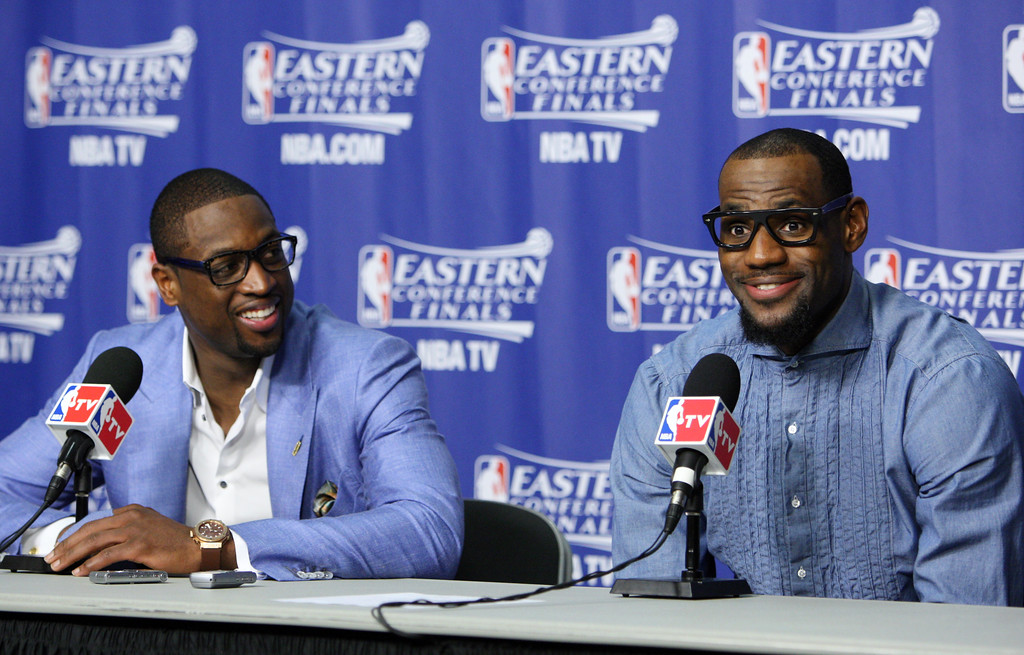 . Miami Heat\'s LeBron James, right, and Dwyane Wade a post game news conference after Game 7 of the NBA basketball playoffs Eastern Conference finals, Saturday, June 9, 2012, in Miami. The Heat defeated the Celtics 101-88.  (AP Photo/Wilfredo Lee)
