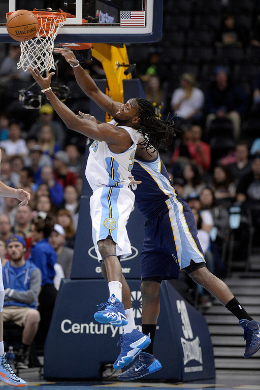 . Denver Nuggets forward Kenneth Faried (35) grabs a rebound away from Memphis Grizzlies forward Zach Randolph (50) during the first quarter. (Photo by AAron Ontiveroz/The Denver Post)