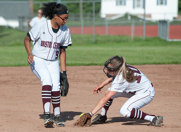 05/21/18 Wesley Bunnell | Staff Bristol Eastern softball defeated Bristol Central on Monday afternoon at Bristol Central High School. Janessa Bartell (9) and Peyton Greger (10) get mixed up going for an infield hit.