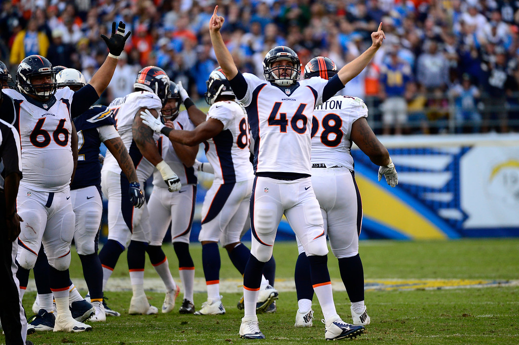 . SAN DIEGO, CA. December 14, - center Manny Ramirez #66 and long snapper Aaron Brewer #46 of the Denver Broncos celebrate a field goal vs the San Diego Chargers at Qualcomm Stadium December 14, 2014 San Diego, CA (Photo By Joe Amon/The Denver Post)