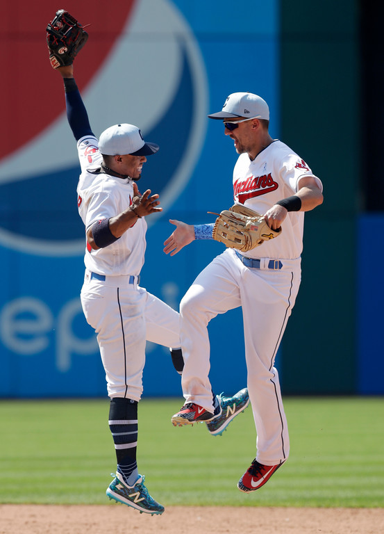 . Cleveland Indians\' Francisco Lindor, left, and Michael Brantley celebrate after they defeated the Minnesota Twins in a baseball game, Sunday, June 17, 2018, in Cleveland. (AP Photo/Tony Dejak)