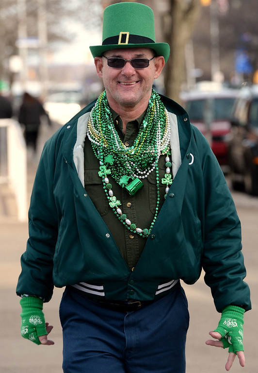 . Tom Parr, 62, walks south along State Street during St. Patrick\'s Day in Erie, Pa. on March 17, 2014.  (AP Photo/Erie Times-News, Greg Wohlford)