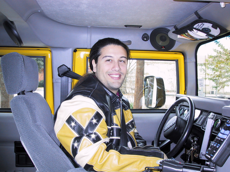 This is me inside my fly-yellow Hummer with the coolass audio/video system.  I got my favorite yellow leather motorcycle jacket in Paris at a store called Rodeo's (Feb 1999).