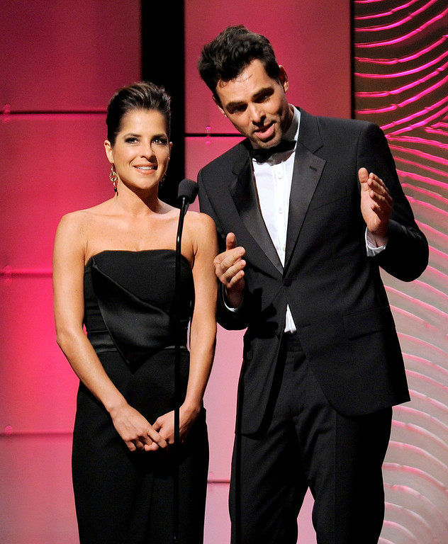 . Kelly Monaco, left, and Jason Thompson speak on stage at the 40th Annual Daytime Emmy Awards on Sunday, June 16, 2013, in Beverly Hills, Calif. (Photo by Chris Pizzello/Invision/AP)