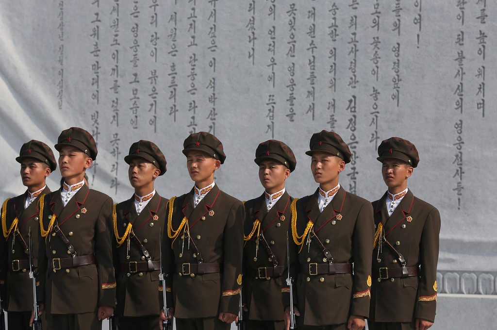 . North Korean soldiers stand at attention at the cemeteries of fallen fighters of the Korean People\'s Army (KPA) on Thursday, July 25, 2013 in Pyongyang, North Korea as part of ceremonies marking the 60th anniversary of the signing of the armistice that ended hostilities on the Korean peninsula. (AP Photo/Wong Maye-E)