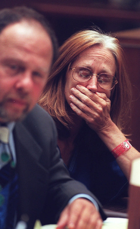 . Former Symbionese Liberation Army member Kathleen Ann Soliah waits for Judge Larry P. Fidler to announce her bail amount Wednesday, July 14, 1999, in Los Angeles Superior Court. At left is her attorney, Stuart Hanlon. Fidler ordered Ms. Soliah, 52, to be held in lieu of $1 million bail. She is accused of placing pipe bombs under two Los Angeles police cars in retaliation for a 1974 shootout with police in which six SLA members were killed. The bombs did not go off. (AP Photo/Los Angeles Times, Rick Meyer)