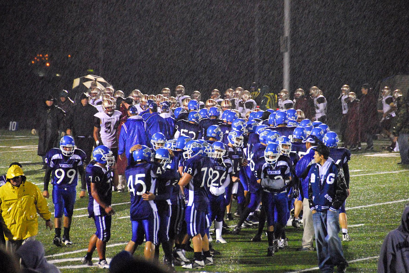 10/5/07 – The varsity game Friday night was another win for PG, but is was cold, wet and miserable all evening. I stayed under an umbrella in the stands and only took a few photos. This was at the end of the game as the two teams met to congratulate each other. You can see Sean on the left – he's #99.