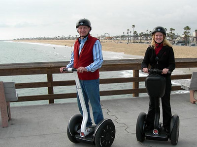 Howard and Pamela taking a Segway ride after completing a training session in Newport Beach in March of 2007.