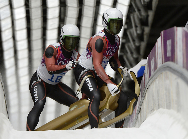 . Latvia\'s Oskars Gudramovics and Peteris Kalnins end their Luge Doubles Run 2 at the Sanki Sliding Center during the Sochi Winter Olympics on February 12, 2014.  (LIONEL BONAVENTURE/AFP/Getty Images)