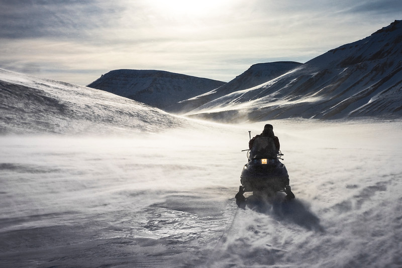 Driving back to camp in strong winds, Liaselv, North-East Greenland