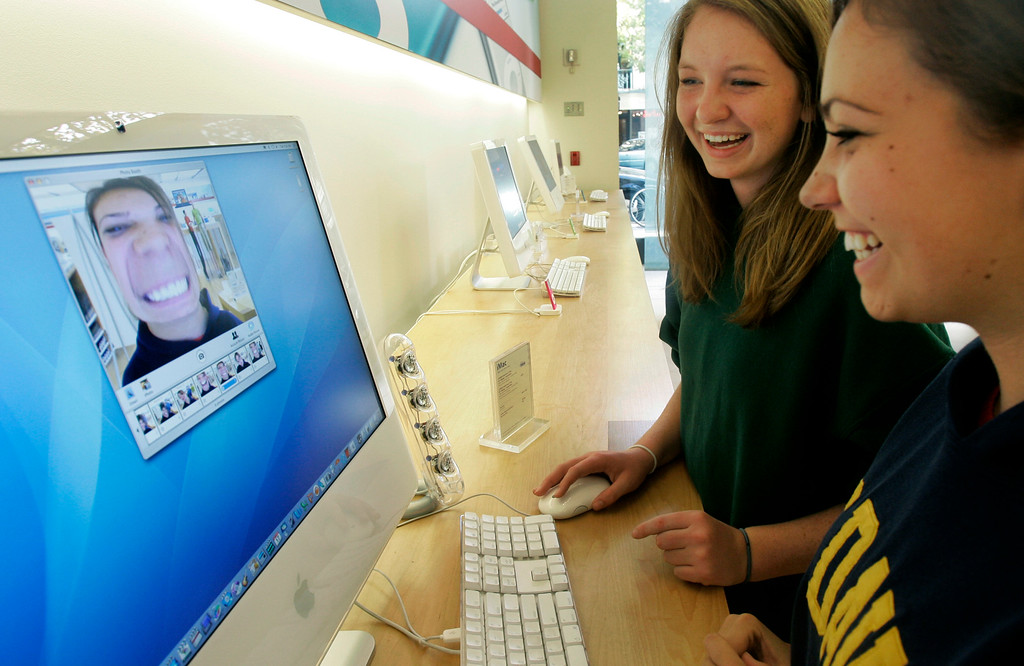 . 2006: You, representing individual content creators on the World Wide Web. Grace Varda, right, and Kelly Hafner, both 16, play with the Photo Booth program on a computer at the Apple Store in Palo Alto, Calif., Tuesday, Nov. 21, 2006. (AP Photo/Jeff Chiu)