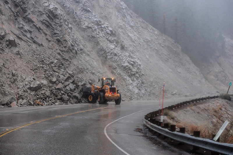 . Caltrans workers clear rocks and mud from the road after heavy rain caused the debris onto Highway 18 in Big Bear Lake, CA on Friday, Feb. 28, 2014. The rocks and mudslides caused a temporary closure of Highway 18 between Running Springs and Big Bear Lake Friday. (Photo by Rachel Luna / San Bernardino Sun)
