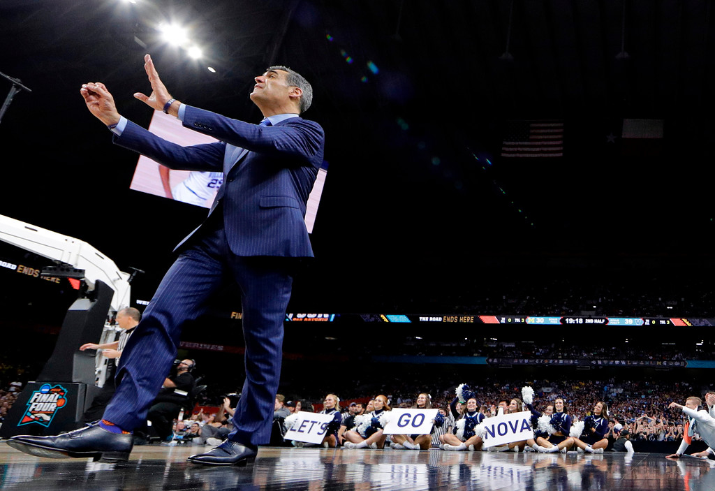 . Villanova head coach Jay Wright directs his team during the second half against Michigan in the championship game of the Final Four NCAA college basketball tournament, Monday, April 2, 2018, in San Antonio. (AP Photo/David J. Phillip)