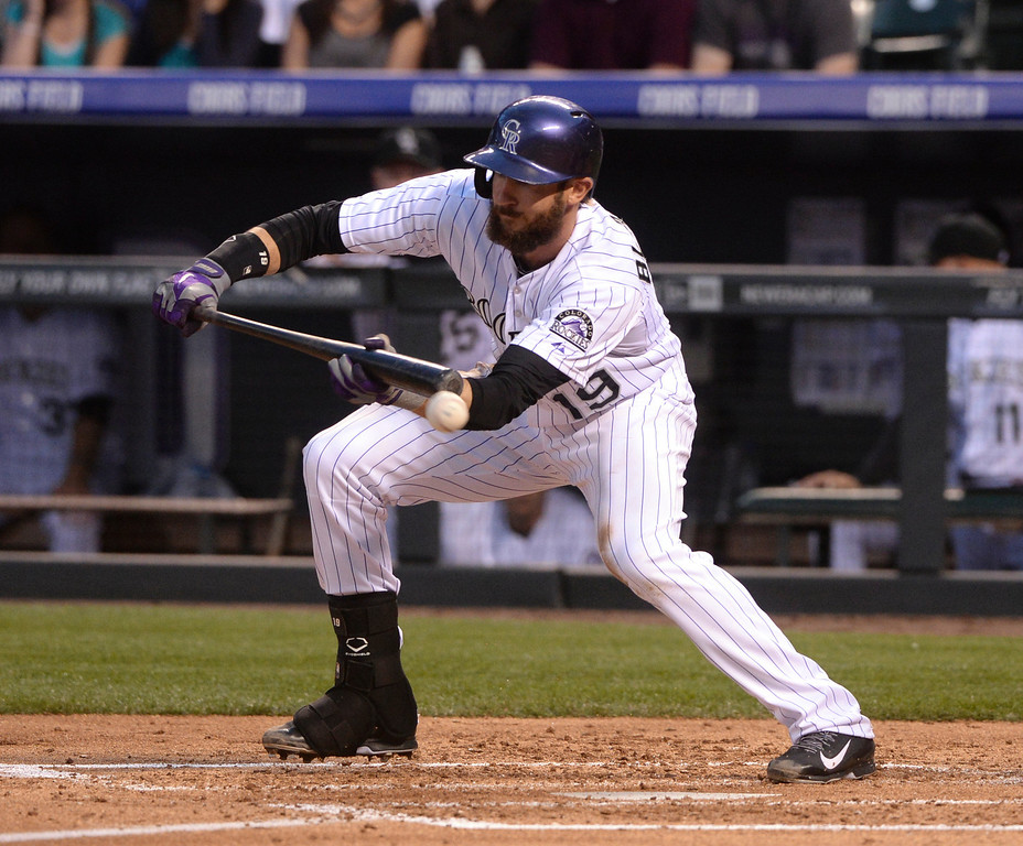 . DENVER, CO - APRIL 18: Colorado batter Charlie Blackmon tried to lay down a bunt in the second inning. It went foul. The Colorado Rockies hosted the Philadelphia Phillies Friday night, April 18, 2014 at Coors Field.  (Photo by Karl Gehring/The Denver Post)