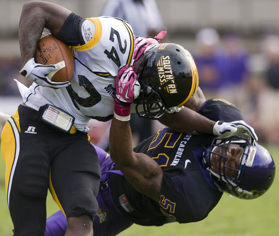 . East Carolina\'s Montese Overton brings down Southern Miss\'s George Payne in the second half during an NCAA college football game at Dowdy-Ficklen Stadium Saturday, Oct. 19, 2013, in Greenville, N.C. (AP Photo/The Daily Reflector, Scott Davis)