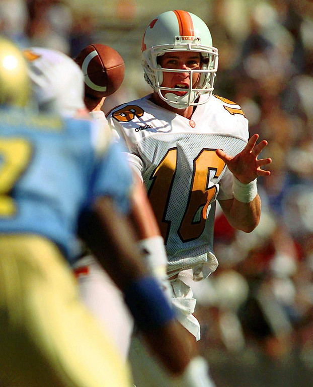 . Tennessee quarterback Payton Manning (16) scrambles against the UCLA defense during the fourth quarter Saturday, Sept. 6, 1997, at the Rose Bowl in Pasadena, Calif. Manning threw for 341-yards and two touchdown to defeat UCLA 30-24. (AP Photo/Susan Sterner)
