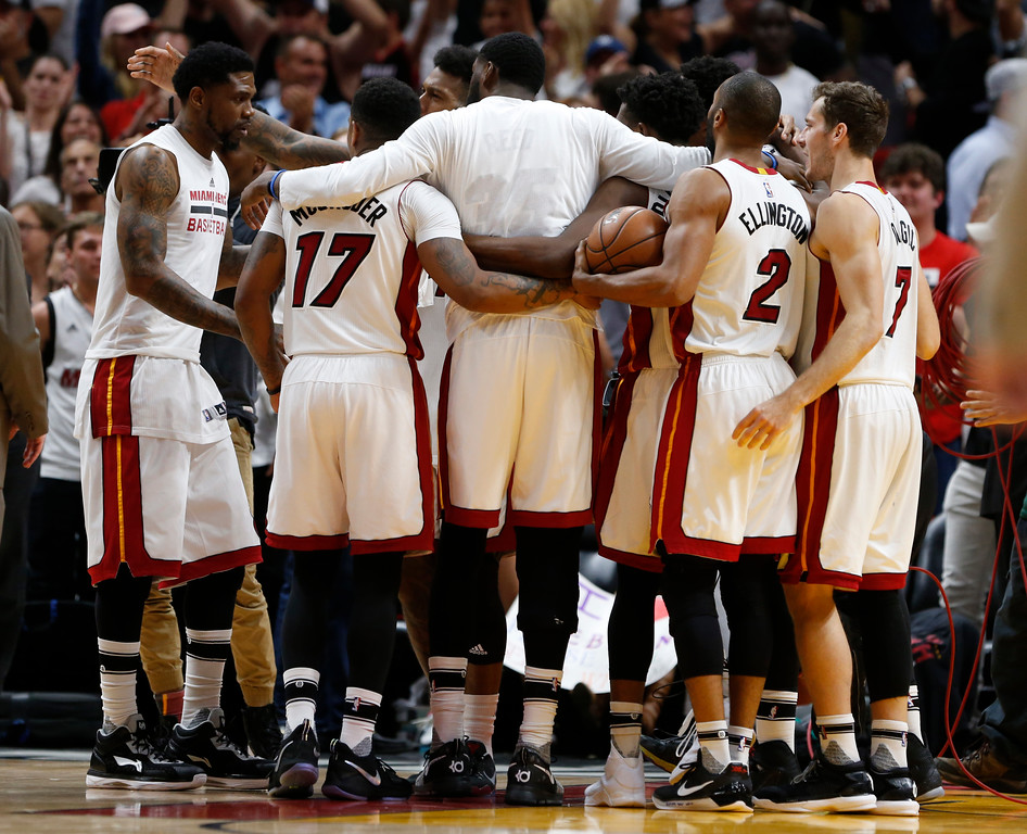 . Miami Heat players celebrate after defeating the Cleveland Cavaliers 124-121 in overtime during an NBA basketball game, Monday, April 10, 2017, in Miami. (AP Photo/Wilfredo Lee)
