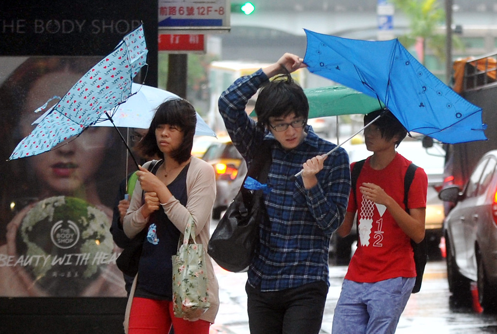 . Pedestrians walk through strong winds and rain caused by Typhoon Fitow in Taipei on October 6, 2013. Taiwan on October 5 issued a warning over Typhoon Fitow as it approached the island\'s north with threats of torrential rains and powerful winds over the weekend.  Mandy Cheng/AFP/Getty Images