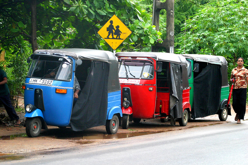 The normal mode of transportation, Rickshaws.
