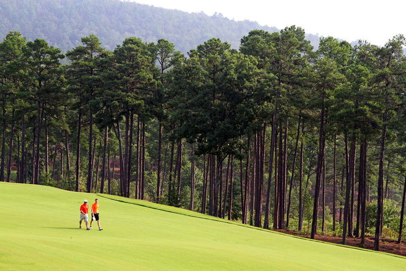 Jordan Niebrugge of Mequon, WI enjoys one last walk down the 18th fairway with his father shortly after the championship match of the 111th Western Amateur at The Alotian Club in Roland, AR. (WGA Photo/Ian Yelton)