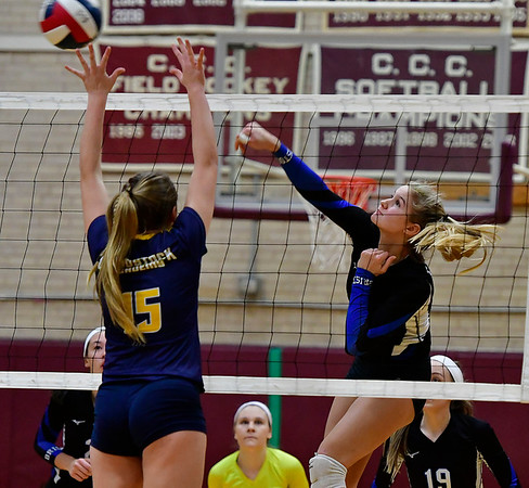 11/14/2018 Mike Orazzi | Staff Bristol Eastern's Zoe Lowe (7)  and Woodstock Academy's Samantha Orlowski (15) during the Class L Semifinal State Girls Volleyball Tournament held at Windsor High School Wednesday night.