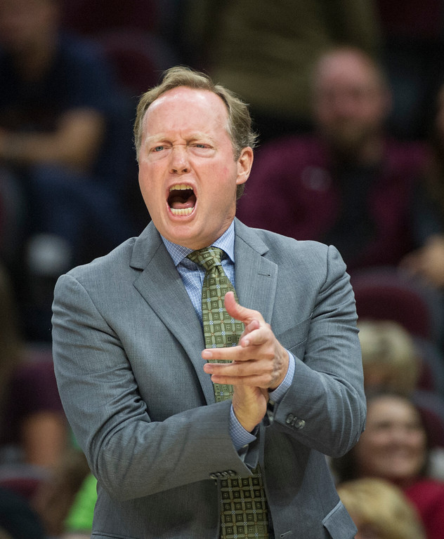 . Atlanta Hawks head coach Mike Budenholzer cheers his team during the first half of an NBA preseason basketball game against the Cleveland Cavaliers in Cleveland, Wednesday, Oct. 4, 2017. (AP Photo/Phil Long)