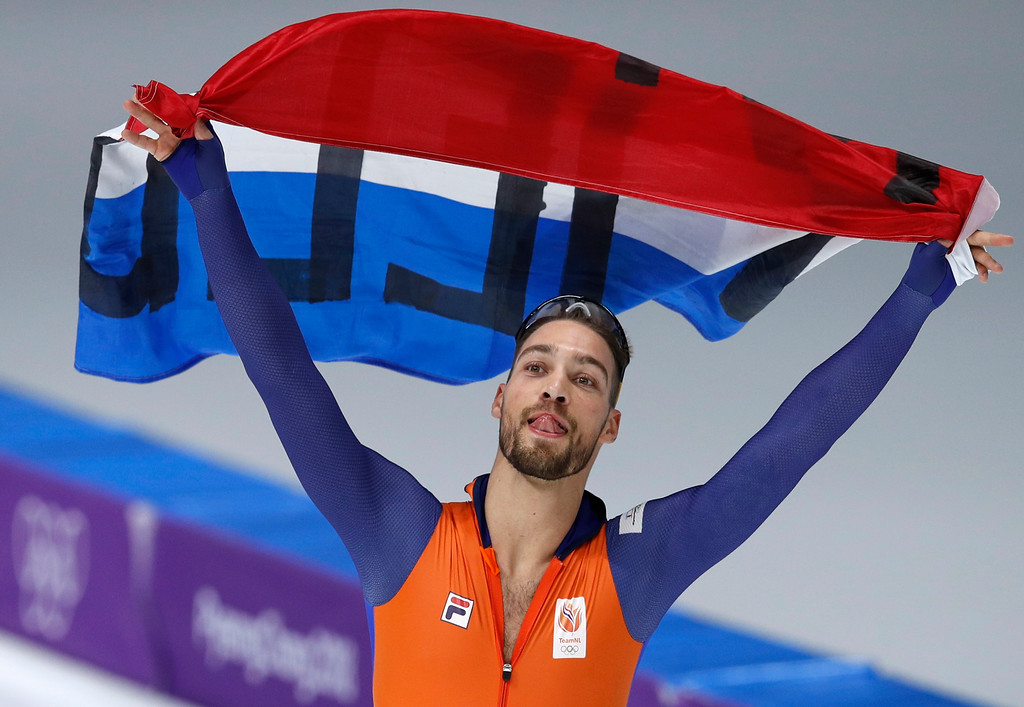 . Gold medalist Kjeld Nuis of The Netherlands celebrates with the national flag after the men\'s 1,000 meters speedskating race at the Gangneung Oval at the 2018 Winter Olympics in Gangneung, South Korea, Friday, Feb. 23, 2018. (AP Photo/Vadim Ghirda)