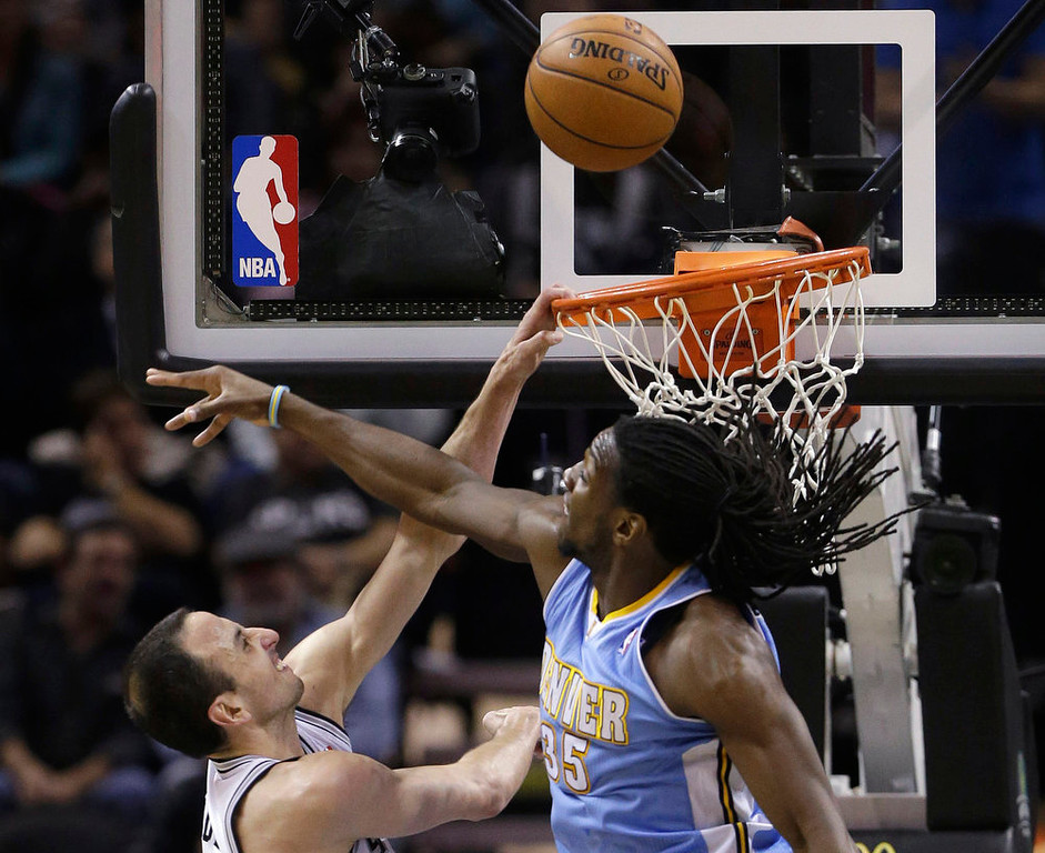 . San Antonio Spurs\' Manu Ginobili, left, of Argentina, goes to the basket as Denver Nuggets\' Kenneth Faried (35) defends during the second half of an NBA basketball game, Wednesday, March 27, 2013, in San Antonio. San Antonio won 100-99. (AP Photo/Eric Gay)