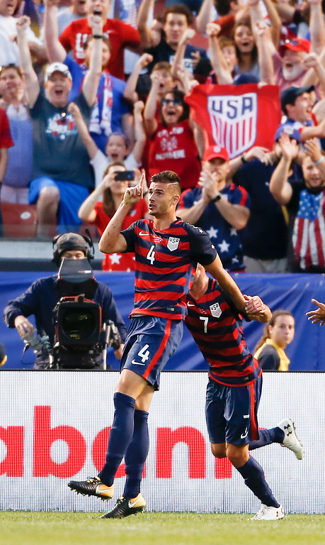 . United States\' Matt Miazga (4) celebrates with Chris Pontius (7) after scoring a goal against Nicaragua during a CONCACAF Gold Cup soccer match in Cleveland, Ohio, Saturday, July 15, 2017. (AP Photo/Ron Schwane)