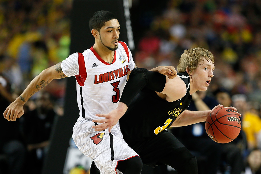 . ATLANTA, GA - APRIL 06:  Ron Baker #31 of the Wichita State Shockers moves the ball against Peyton Siva #3 of the Louisville Cardinals in the first half during the 2013 NCAA Men\'s Final Four Semifinal at the Georgia Dome on April 6, 2013 in Atlanta, Georgia.  (Photo by Kevin C. Cox/Getty Images)