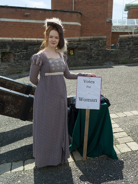 "Woman standing with placard saying ""Votes for Women"", Derry City Walls, Londonderry, Northern Ireland, United Kingdom"