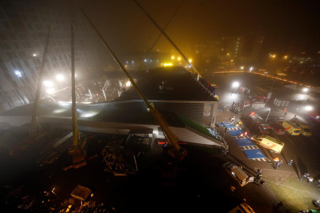 . A view of collapsed Maxima supermarket in Riga, Latvia, Friday, Nov. 22, 2013.  (AP Photo/Mindaugas Kulbis)
