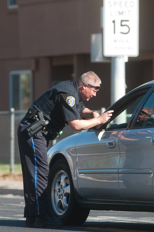 . A police officer stops traffic near Agnes Risley Elementary school following a shooting at nearby Sparks Middle School October 21, 2013 in Sparks, Nevada.  (Photo by David Calvert/Getty Images)