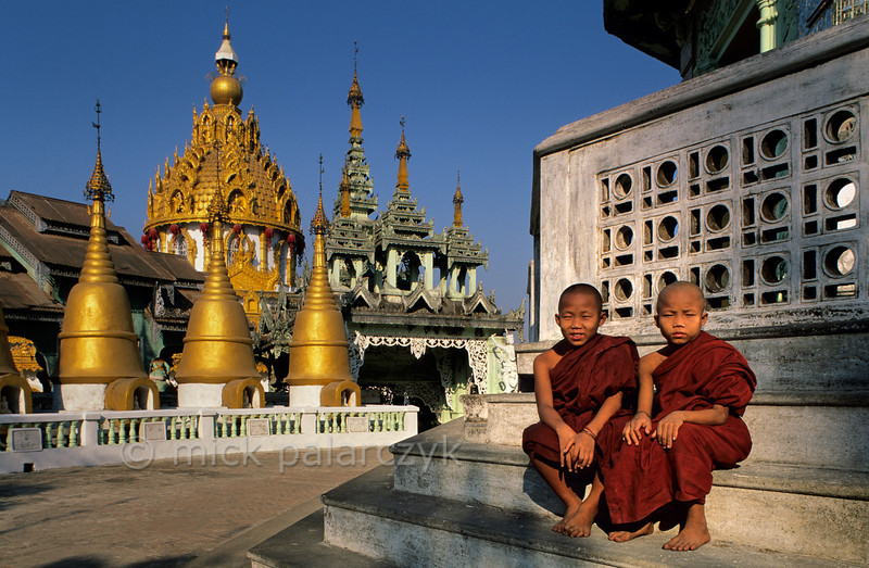 [BURMA 24.710] 'Monks at Insein.'  Young Buddhist monks on the central square of the Ah Lain Nga Sint Pagoda at the village of Insein, north of Yangon. Photo Mick Palarczyk.