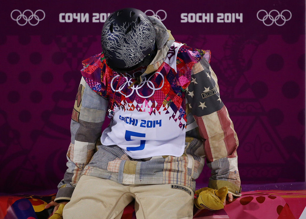 . Gregory Bretz of the United States waits for his score in the Snowboard Men\'s Halfpipe Finals on day four of the Sochi 2014 Winter Olympics at Rosa Khutor Extreme Park on February 11, 2014 in Sochi, Russia.  (Photo by Al Bello/Getty Images)