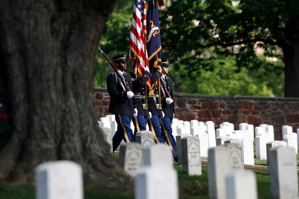 . Army honor guard members arrive at the gravesite of Army Pvt. William Christman, who was the first military burial at the cemetery, marking the beginning of commemorations of the 150th anniversary of Arlington National Cemetery in Arlington, Va., Tuesday, May 13, 2014. (AP Photo)
