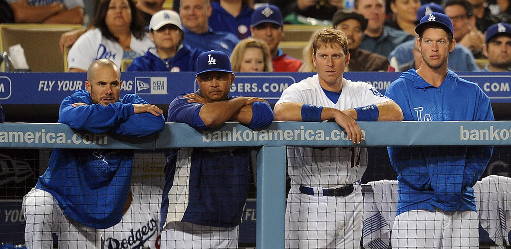 . Los Angeles Dodgers starting pitcher Clayton Kershaw, right, along with the bench look on as the San Francisco Giants won 5-3 during their baseball game on Wednesday, April 3, 2013 in Los Angeles. San Francisco Giants won 5-3. 