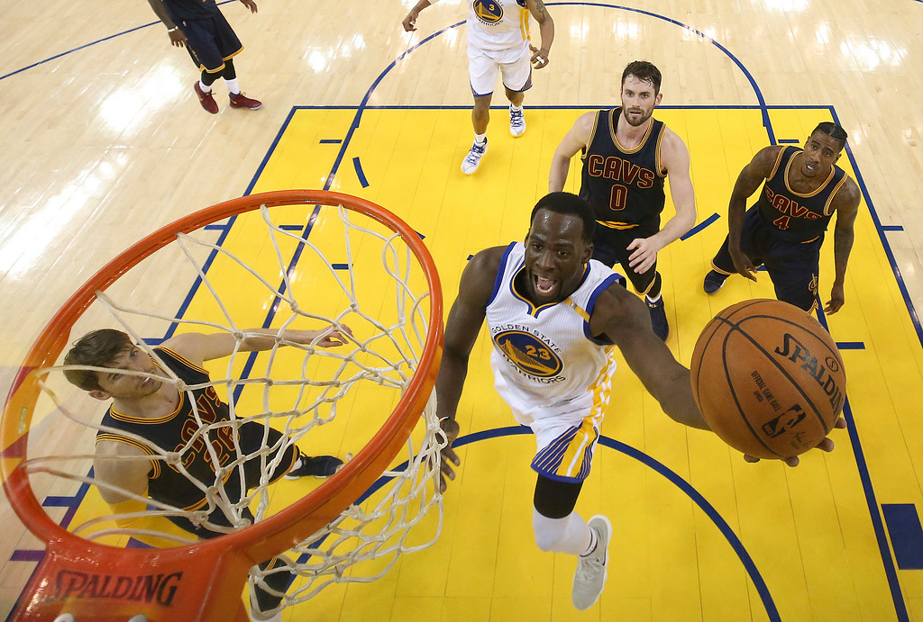 . Golden State Warriors forward Draymond Green (23) shoots against the Cleveland Cavaliers during the first half of Game 1 of basketball\'s NBA Finals in Oakland, Calif., Thursday, June 1, 2017. (Ezra Shaw/Pool Photo via AP)