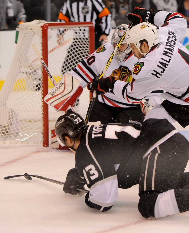 . The Kings\' Tyler Toffoli is knocked over by the Blackhawks\' Niklas Hjalmarsson in front of the Blackhawks\' net during game six of the Western Conference Finals, Friday, May 30, 2014, at Staples Center. (Photo by Michael Owen Baker/Los Angeles Daily News)
