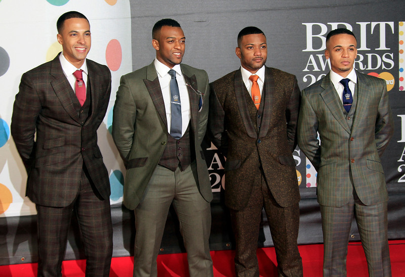 . From left, Marvin Humes, Oritse Williams, Jonathan \'JB\' Gill and Aston Merrygold of British band JLS seen arriving at the BRIT Awards 2013 at the o2 Arena in London on Wednesday, Feb. 20, 2013. (Photo by Joel Ryan/Invision/AP)