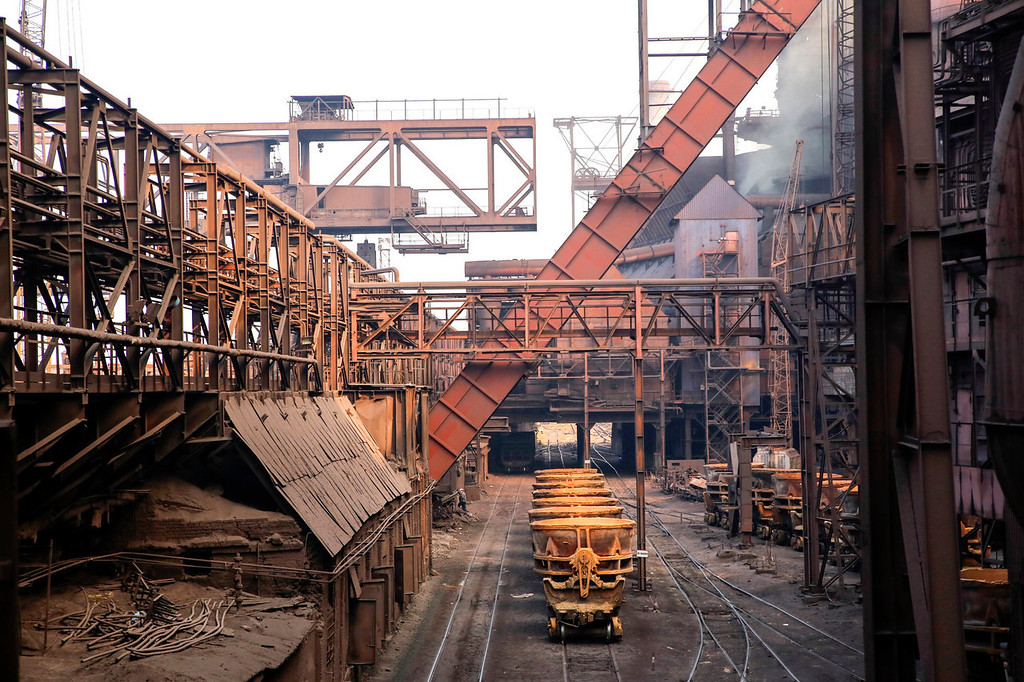. Steel cauldrons sit on rail wagons outside the Zaporizhstal steel plant, owned and operated by Metinvest BV, at their site in Zaporizhzhya, Ukraine, on Monday, Oct. 14, 2013. Metinvest BV, Ukraine\'s largest steelmaker, last year acquired 49.9% in steelmaker Zaporizhstal a manufacturer of semi-finished steel products, including hot and cold-rolled plates and coils. Photographer: Vincent Mundy/Bloomberg