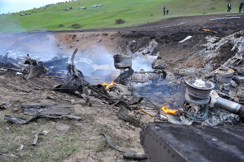 . The remains of a crashed US KC-135 Stratotanker plane are seen on a hill near the villages of Chorgolo and Cholok-Aryk, Kyrgyzstan, on May 3, 2013. The refuelling plane from the U.S. Manas airbase in Kyrgyzstan crashed after taking off, the emergency situations ministry told AFP on Friday. Among the dead are Air Force Capt. Victoria Pinckney of Palmdale, a mother of a baby. (AFP/Getty Images)