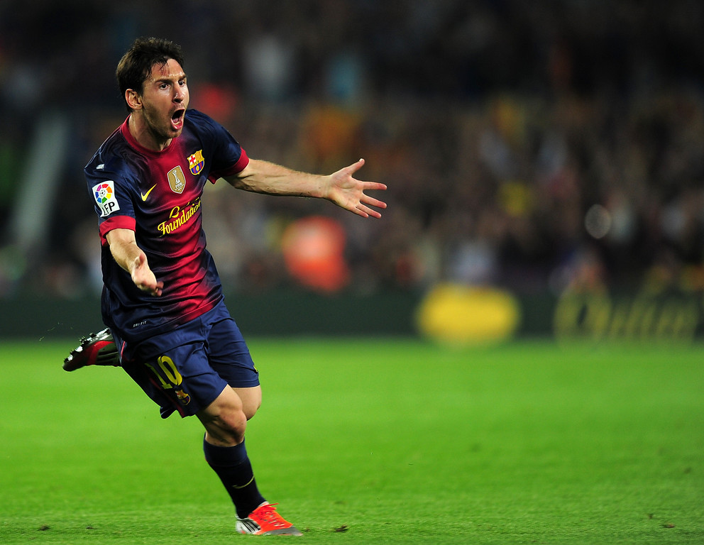 . Barcelona\'s Argentinian forward Lionel Messi celebrates after scoring his second goal during the Spanish League Clasico football match FC Barcelona vs Real Madrid CF on October 7, 2012 at the Camp Nou stadium in Barcelona.  LLUIS GENE/AFP/Getty Images
