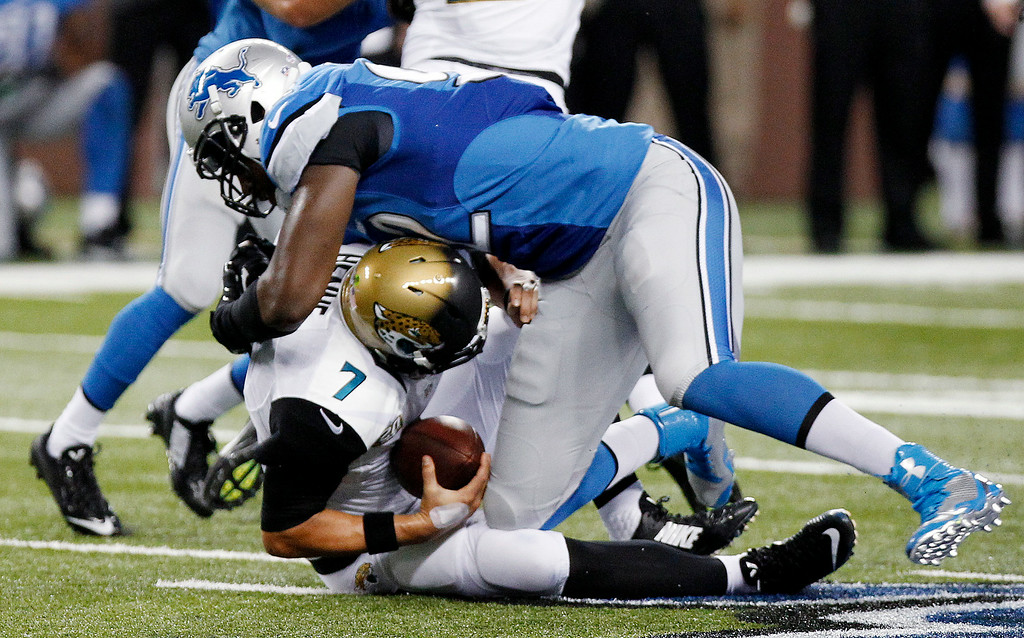 . Detroit Lions defensive end Devin Taylor (92) sacks Jacksonville Jaguars quarterback Chad Henne (7) in the first half of a preseason NFL football game at Ford Field in Detroit, Friday, Aug. 22, 2014.  (AP Photo/Duane Burleson)