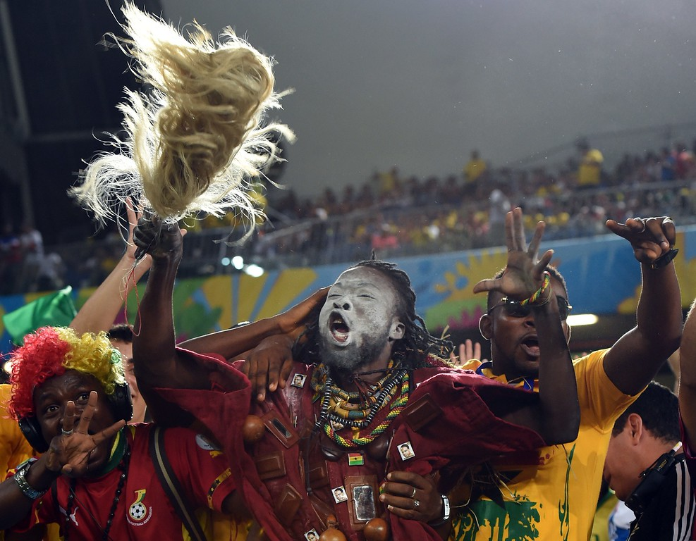 . Ghana\'s fans cheer before the start of a Group G football match between Ghana and US at the Dunas Arena in Natal during the 2014 FIFA World Cup on June 16, 2014.  AFP PHOTO / CARL  DE SOUZA/AFP/Getty Images