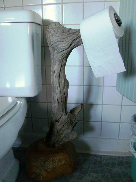 Toilet paper holder made from local stone and drift wood