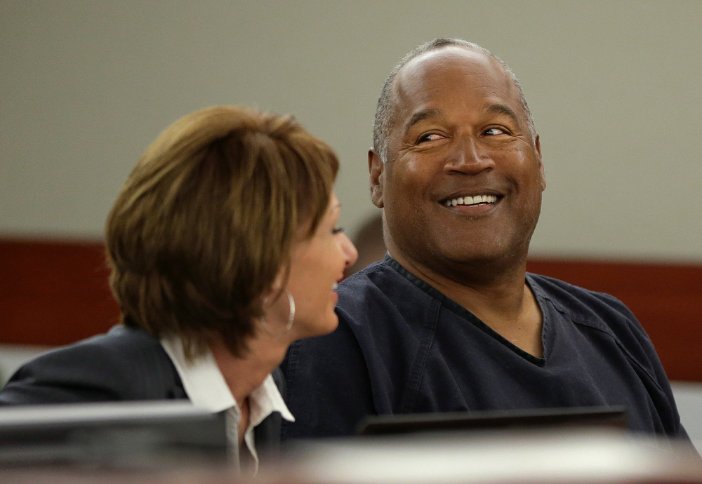 . O.J. Simpson, right, talks with his attorney, Patricia Palm in Clark County District Court, Monday, May 13, 2013 in Las Vegas. Simpson, who is currently serving a nine-to-33-year sentence in state prison as a result of his October 2008 conviction on armed robbery and kidnapping charges, is seeking a new trial, claiming that trial lawyer Yale Galanter had conflicted interests and shouldn\'t have handled Simpson\'s armed case. (AP Photo/Julie Jacobson, Pool)