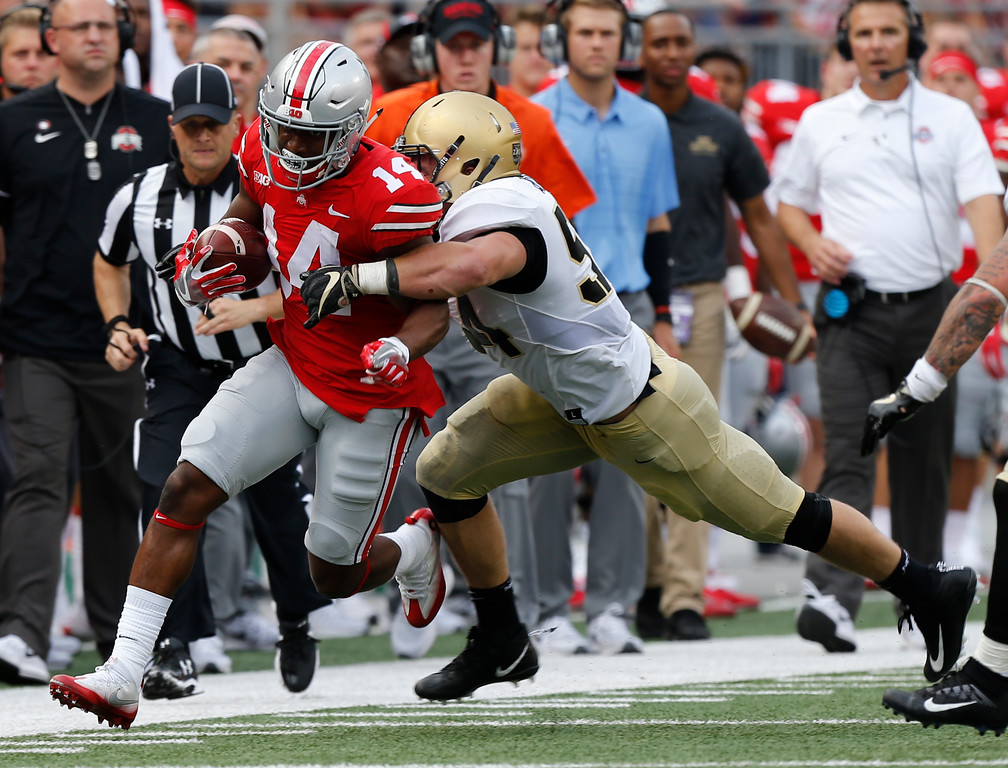 . Ohio State receiver K.J. Hill, left, is forced out of bounds by Army linebacker Cole Christiansen during the first half of an NCAA college football game Saturday, Sept. 16, 2017, in Columbus, Ohio. (AP Photo/Jay LaPrete)