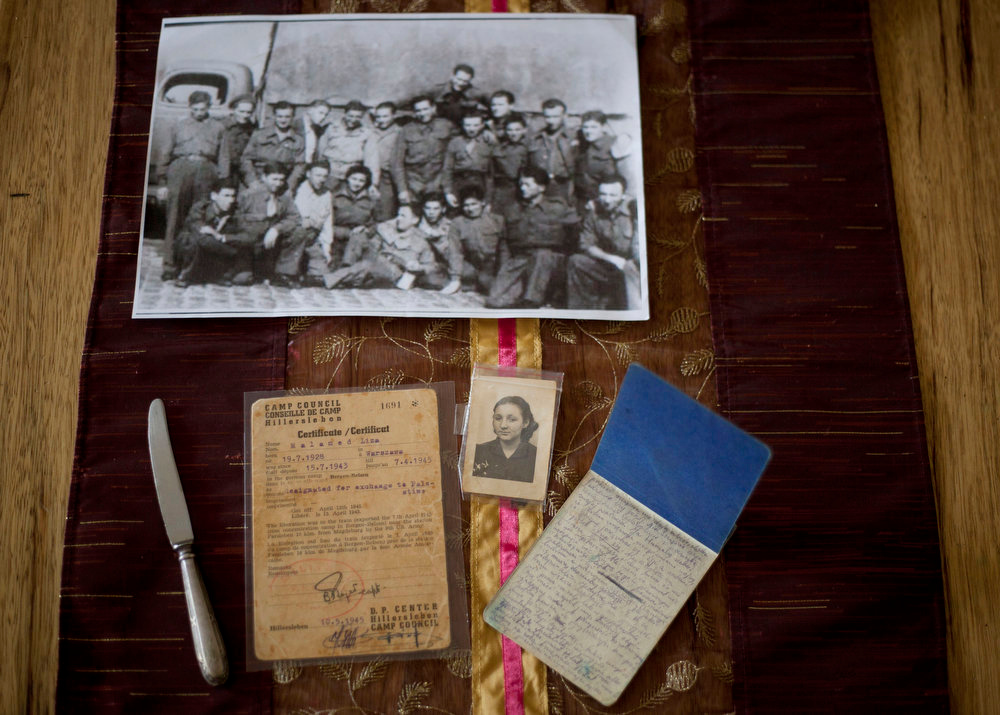 . Warsaw ghetto Holocaust survivor Aliza Vitis-Shomron\'s private mementos placed on a table at her living room in Kibbutz Givat Oz, Israel on April 4, 2013. Two days before her comrades embarked on an uprising that came to symbolize Jewish resistance against the Nazis in World War II, 14-year-old Aliza Mendel got her orders: Escape from the Warsaw Ghetto. The end was near. Nazi troops had encircled the ghetto, and the remaining Jewish rebels inside were prepared to die fighting. Her job, they told her, was to survive and tell the world about how the fighters died resisting the Nazis. In the 70 years since the revolt, she\'s been doing just that, publishing a memoir about life in the ghetto and lecturing about the uprising. (AP Photo/Ariel Schalit)